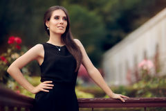 Elegant Woman Wearing Black Dress Standing in a Patio Royalty Free Stock Photos