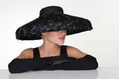 Elegant Woman Wearing Black Hat and Gloves Stock Photography