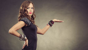 Elegant woman wearing bracelets holds open hand Stock Photography