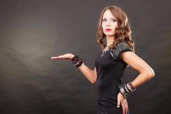 Elegant woman wearing bracelets holds open hand Royalty Free Stock Photos