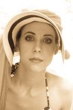 Elegant woman wearing heat Royalty Free Stock Photography