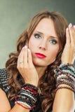 Elegant woman wearing multiple bracelets Royalty Free Stock Image