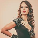 Elegant woman wearing multiple bracelets Stock Photo