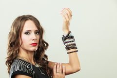 Elegant woman wearing multiple bracelets Stock Images