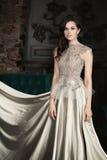 Elegant Woman Wearing a Silver Dress Stock Photo
