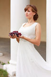 Elegant woman in white dress with grapes Stock Photo