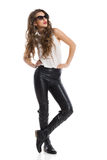 Elegant Woman In White Shirt And Black Leather Trousers Stock Image