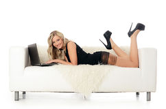 Elegant woman on a white sofa with the laptop. Business conc Royalty Free Stock Photo