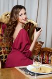 Elegant woman with a wine glass at smart restaurant Stock Photo