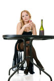 Elegant woman with wine in hands in cafe Royalty Free Stock Photography
