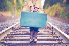 Elegant Woman With A Suitcase Traveling By Rail Stock Photography