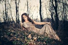 Elegant woman in wood Stock Photos