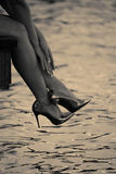 Elegant womans legs with shiny heels Royalty Free Stock Images