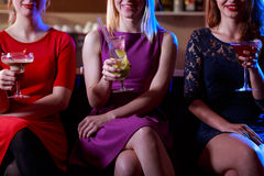 Elegant women in the bar. Young elegant women with drinks in the bar Royalty Free Stock Photo