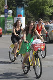 Elegant women on bikes Royalty Free Stock Photo