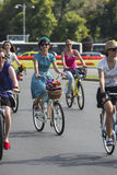 Elegant women on bikes Royalty Free Stock Image