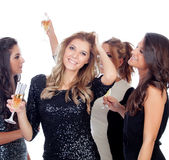 Elegant women celebrating christmas dancing in the party Royalty Free Stock Photos