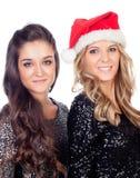 Elegant women celebrating christmas Royalty Free Stock Images