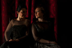 Elegant women in darkness Royalty Free Stock Images