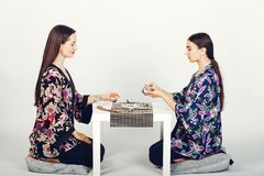 Beautiful girls drinking a tea in a studio royalty free stock image