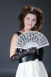 Elegant women   with fan Stock Images