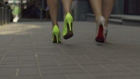 Elegant women in high heels taking a walk on street stock video