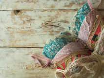 Elegant women`s bras laying on the wooden background. Stock Photos