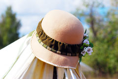 Elegant women's hat decorated by flowers. Stock Image