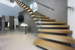 Elegant wood and glass staircase in luxury home Stock Images