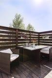 Elegant wooden balcony with garden furniture Stock Photos