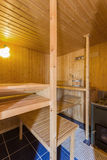 Elegant wooden domestic sauna sauna with a stove. Royalty Free Stock Photography