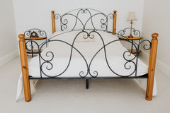 Elegant wooden and metal bed Royalty Free Stock Photography