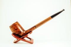 Elegant wooden tobacco pipe Stock Photos