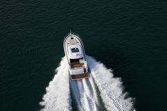 Elegant yacht sailing though deep waters Royalty Free Stock Photo