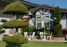 Elegant yard. Elegant front yard with decorative shrubs and bushes Royalty Free Stock Photo