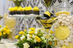 Elegant yellow and black sweet table. With macaroon and cupcakes on wedding or event party stock photo