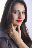 Elegant young armenian girl looking straight. Cute young armenian girl with red lips posing in studio stock photography