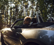 Elegant young attractive man in convertible car outdoor. Royalty Free Stock Photo