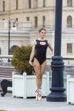 Elegant young ballerina dancing outdoors Stock Image
