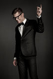 Elegant young black suit man royalty free stock images