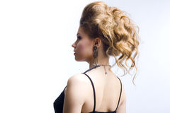 Elegant young blond girl. Profile view Royalty Free Stock Photos