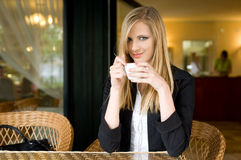 Elegant young blond woman on cofffee break. Royalty Free Stock Photo