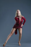 Elegant young blond woman dancing in studio Royalty Free Stock Images