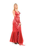 Elegant young blonde in red dress. Isolated Royalty Free Stock Photo