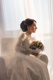 Elegant young bride in wedding dress, studio shot Royalty Free Stock Photos
