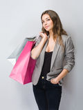 Elegant young brunette shopper. Royalty Free Stock Photography