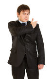 Elegant young businessman brushing his suit Stock Image