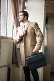 Elegant young businessman looking out the window. royalty free stock photo