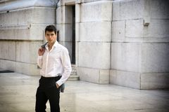 Elegant young businessman outdoor, marble wall and Stock Photography