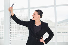 Elegant young businesswoman shouting into the phone royalty free stock image